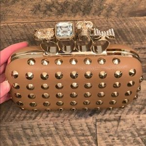 Natasha Couture Brass Knuckle Studded Clutch